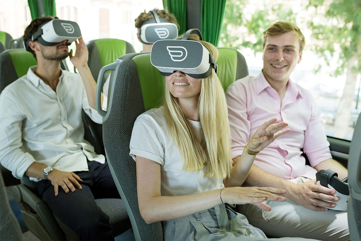 group of people enjoying inflight VR experience on Flixbus